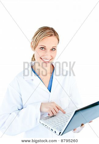 Charming Female Doctor Holding A Laptop Looking At The Camera