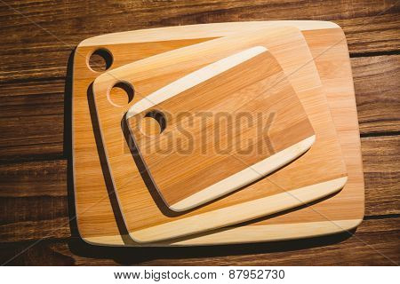 Chopping boards on wooden table shot in studio