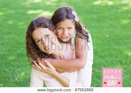 mothers day greeting against happy mother and daughter smiling at camera