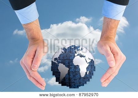 Close up of businessman with hands spread on the floor against cloudy sky
