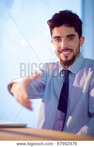 Businessman offering to shake hands shot in studio