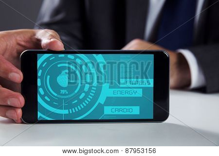 Businessman using smartphone against fitness interface
