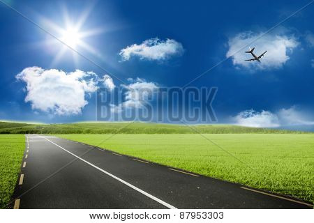 Graphic airplane against road leading out to the horizon