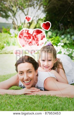 Red heart against mother and daughter smiling at camera