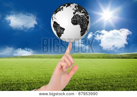Businesswoman pointing against sunny green landscape