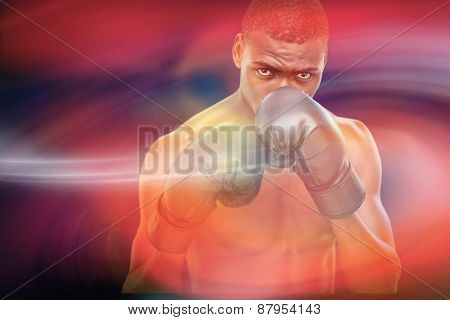 Muscular boxer against sunrise sky
