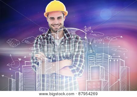 Handome male repairman standing arms crossed against green field at night