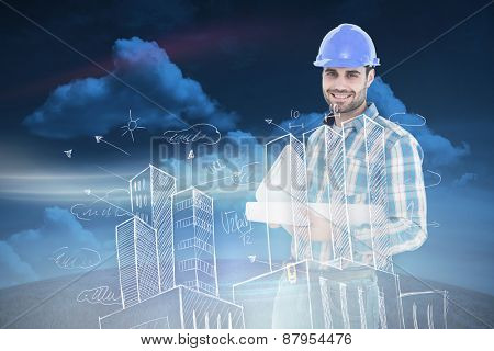 Confident architect holding bluprint and clipboard against green field under blue sky