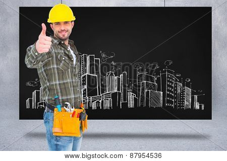 Confident manual worker gesturing thumb up against composite image of black card
