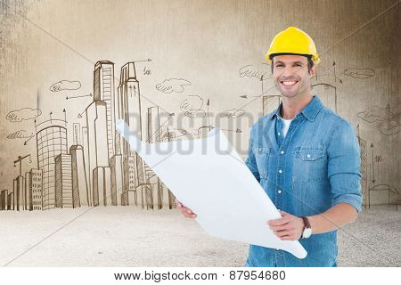 Happy architect holding blueprint in house against hand drawn city plan