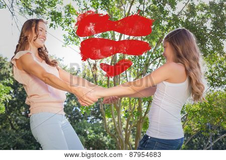 Heart against happy woman and girl holding hands under the tree
