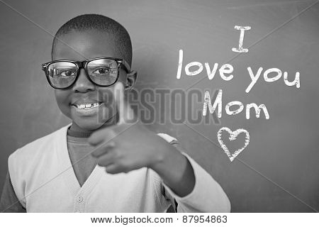 Schoolchild with blackboard against mothers day greeting