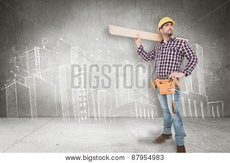 Handyman holding wood planks against hand drawn city plan