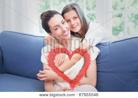 Red smoke heart against mother and daughter smiling at camera