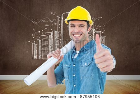 Architect holding blueprint while gesturing thumbs up against room with wooden floor