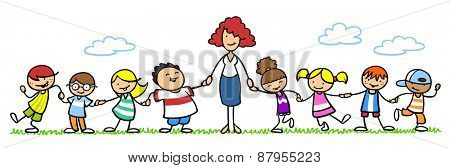 Female educator with group of kindergarten children outside in nature