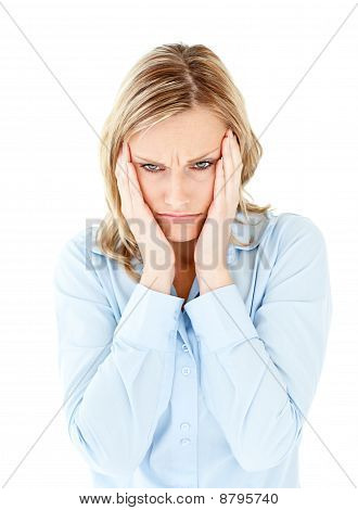 Downcast Businesswoman Taking Her Head Between Her Hands