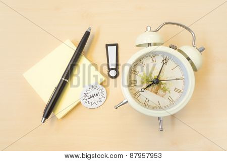 Alert Sign With Urgent Alarm Clock And Sticky Postit And Pen On Wood Table