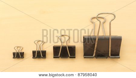 Four Different Size Of Black Paper Clips