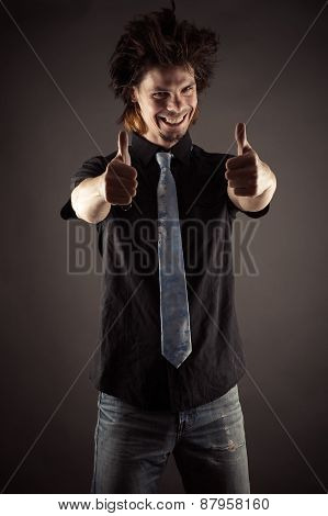 young businessman showing finger up gesture