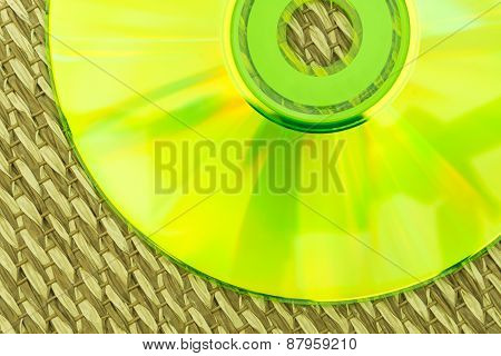 Half Green Cd Placed On A Japanese Mat