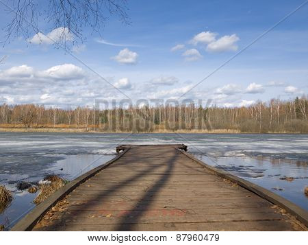 Fishermen bridge on the river in the spring
