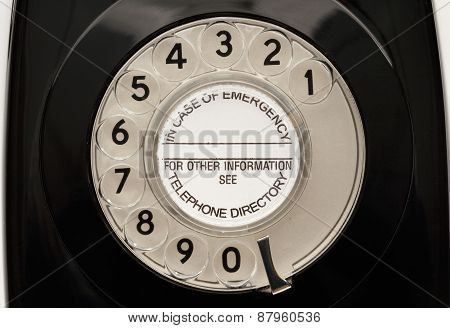 Rotary phone dial close up