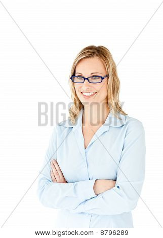 Confident Businesswoman With Folded Arms Smiling At The Camera