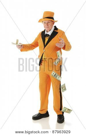 A flamboyant senior adult in a bright orange tuxedo and hat, carelessly offering money and dropping big bills.  On a white background.