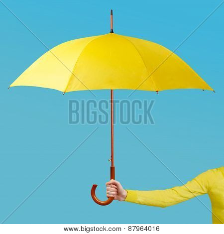 Hand holding an umbrella
