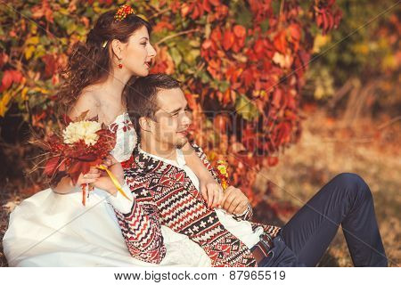 Portrait Of Bride And Groom In Autumn Park