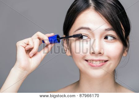 Asian Female Applying Mascara