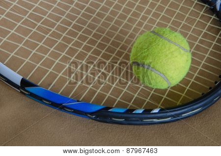 A Tennis Racket With  Tennis Ball