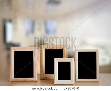 photo frames on the wooden table in the living room