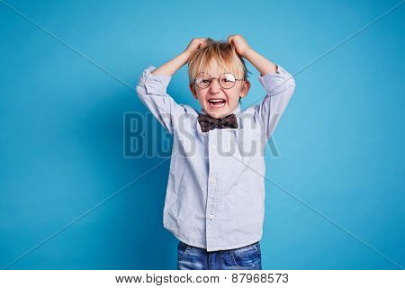 Little boy in smart casual expressing dissatisfaction