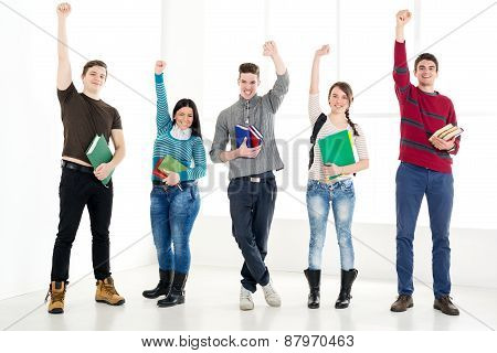 Group Of Successful Students With Book's