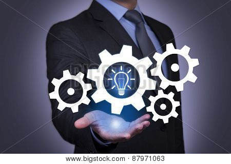 Idea And Gear on Businessman Hand