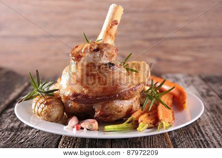 roasted lamb meat and vegetables