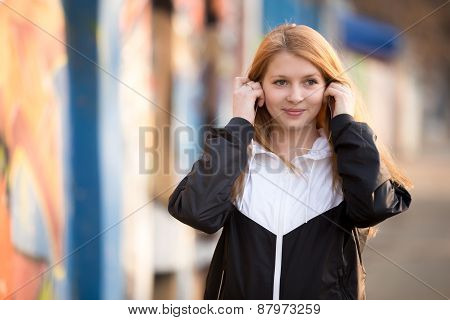 Sporty Girl Putting On Earphones