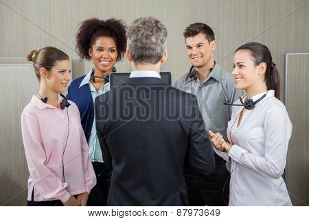 Manager discussing with employees at call center