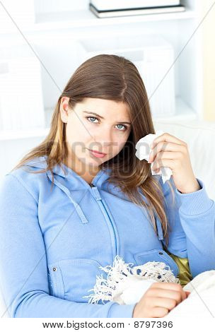 Sick Young Woman Holding A Tissue