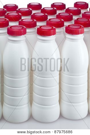 dairy products bottles with bright covers . Still-life