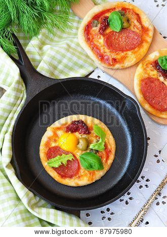 Pepperoni mini pizza and egg for breakfast