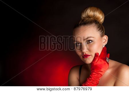 Attracktive woman in red gloves