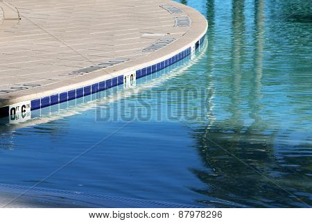 Close up view of a shallow pool and deck