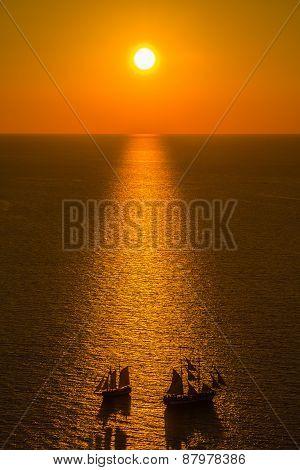 Beautiful Sunset Over Santorini Caldera With Two Boats Crossing, Oia, Santorini, Greece