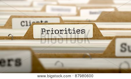 Priorities Concept with Word on Folder.