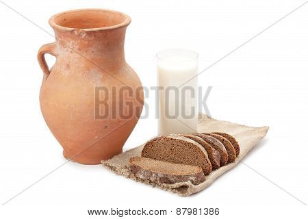 Old Clay Jug, A Glass Of Milk And Bread
