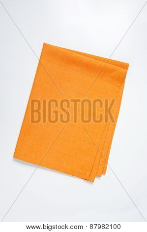 orange tablecloth on white background