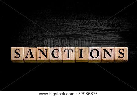 Word Sanctions Isolated On Black Background